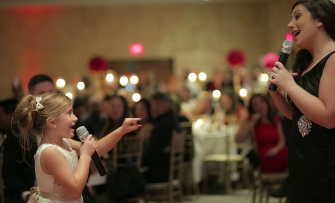 awesome flower girl sings with mom song open door