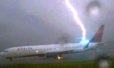 viral plane lightning strikes delta flight