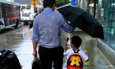 daddy drench rain holding umbrella to son viral online