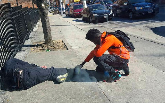 Viral Photo Boy praying over a sleeping homeless guy in Baltimore