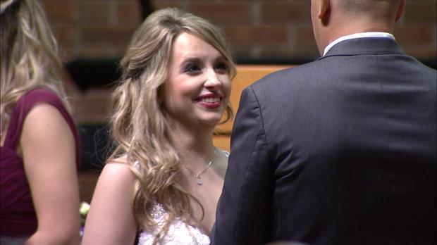 Heather Krueger reads her wedding vows