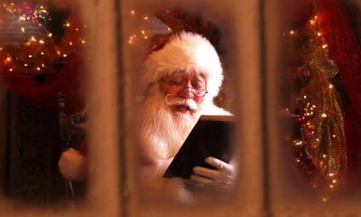Eric Schmitt-Matzen reading book as Santa Claus