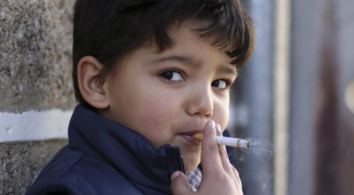 Portugal celebrates Epiphany with children 5 years old smoking cigarettes