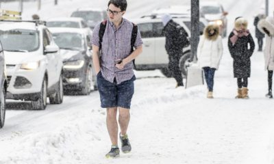 University of Wisconsin-Madison student walking shorts in snow