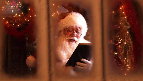 Eric Schmitt-Matzen reading book as Santa Claus